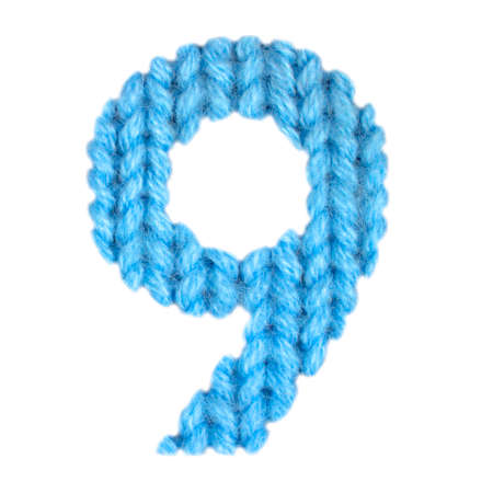 Number 9 (nine) alphabet on a blurry texture knitted pattern of woolen thread closeup. One figure of the alphabet. Education and holidays. Typography design. Color blue Foto de archivo