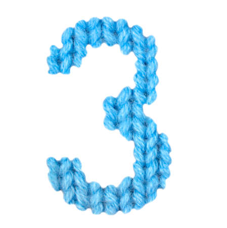 Number 3 (three) alphabet on a blurry texture knitted pattern of woolen thread closeup. One figure of the alphabet. Education and holidays. Typography design. Color blue
