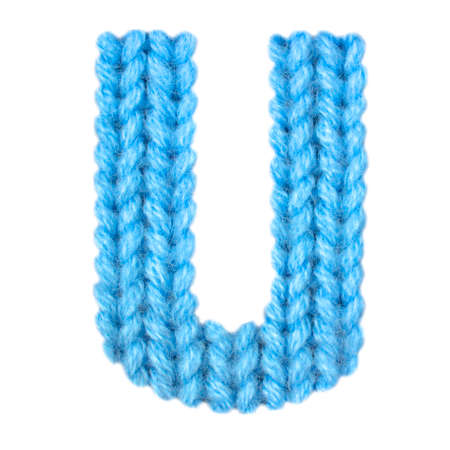 Letter U Alphabet On A Blurry Texture Knitted Pattern Of Woolen