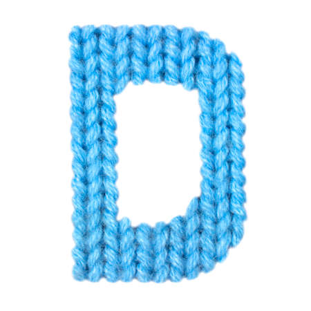 Letter D alphabet on a blurry texture knitted pattern of woolen thread closeup. One letter of the English alphabet. Education and holidays. Typography design. Color blue