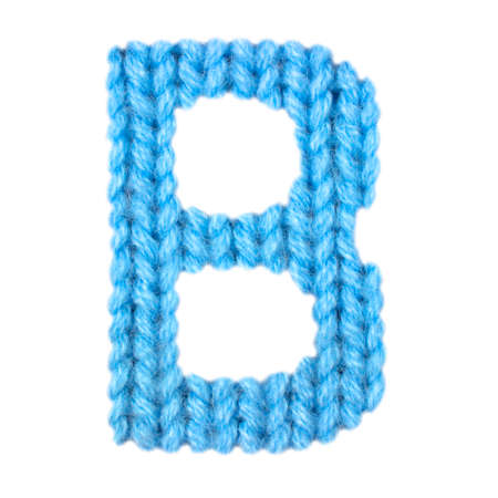 Letter B Alphabet On A Blurry Texture Knitted Pattern Of Woolen