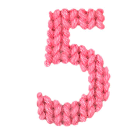 Number 5 (five) alphabet on a blurry texture knitted pattern of woolen thread closeup. One figure of the alphabet. Education and holidays. Typography design. Color red
