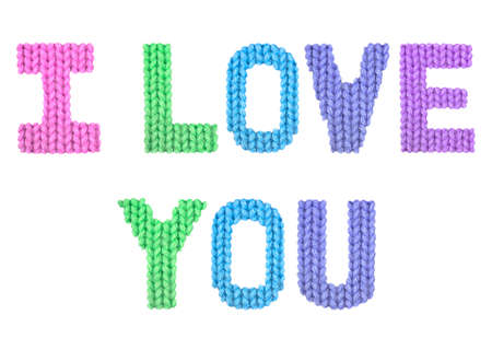 I love you word on a blurry texture knitted pattern of woolen thread closeup. English alphabet. Typography design. Color rainbow Reklamní fotografie