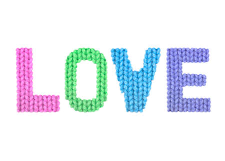 Love word on a blurry texture knitted pattern of woolen thread closeup. English alphabet. Typography design. Color rainbow