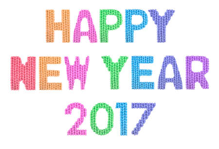 Happy new year 2017 word on a blurry texture knitted pattern of woolen thread closeup. English alphabet. Typography design. Color rainbow