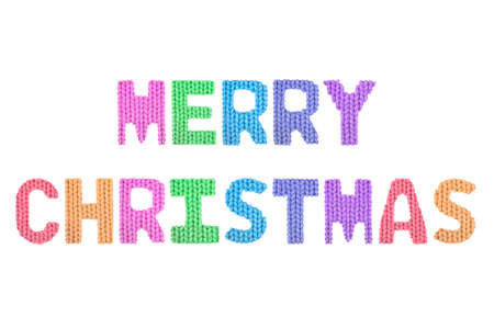 Merry christmas word on a blurry texture knitted pattern of woolen thread closeup. English alphabet. Typography design. Color rainbow