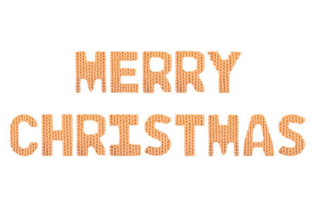 Merry christmas word on a blurry texture knitted pattern of woolen thread closeup. English alphabet. Typography design. Color orange