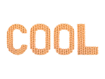 Cool word on a blurry texture knitted pattern of woolen thread closeup. English alphabet. Typography design. Color orange