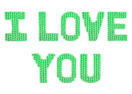 I love you word on a blurry texture knitted pattern of woolen thread closeup. English alphabet. Typography design. Color green Reklamní fotografie