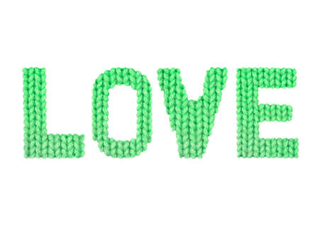 Love word on a blurry texture knitted pattern of woolen thread closeup. English alphabet. Typography design. Color green