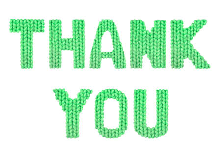 Thank you word on a blurry texture knitted pattern of woolen thread closeup. English alphabet. Typography design. Color green