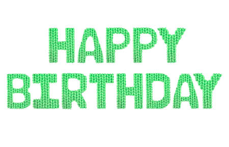 Happy birthday word on a blurry texture knitted pattern of woolen thread closeup. English alphabet. Typography design. Color green