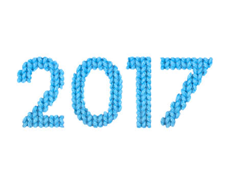 2017 numbers on a blurry texture knitted pattern of woolen thread closeup. English alphabet. Typography design. Color blue
