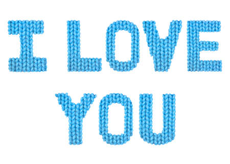I love you word on a blurry texture knitted pattern of woolen thread closeup. English alphabet. Typography design. Color blue