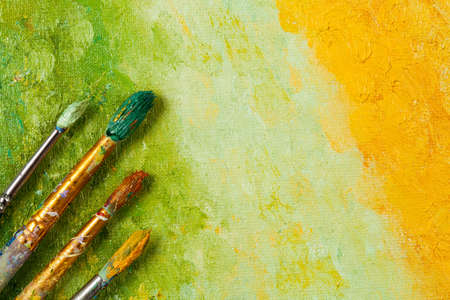 artist: Vintage artists brushes on an abstract artistic background Stock Photo