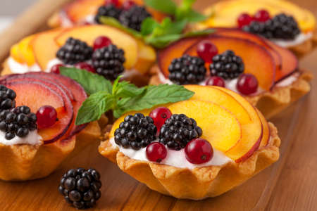 Tarts with froots on the wooden desk