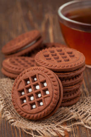Chocolate oreo cookies and tea on the table