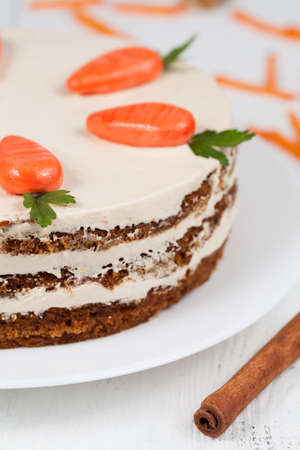 carrot cake: Homemade carrot cake pasrty with icing on white plate background Stock Photo