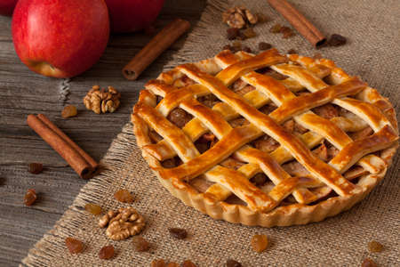 netherlandish: Apple pie with cinnamon on retro wooden background texture Stock Photo