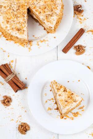 Portion of sliced easter carrot sponge cake on white table background photo