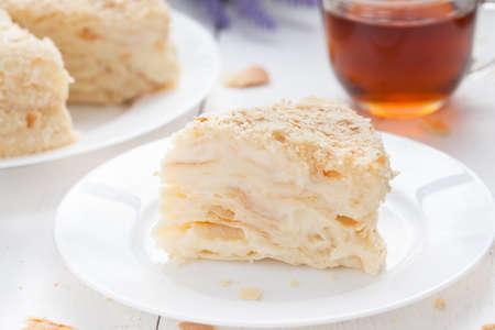 custard slice: Custard  slice cake in vintage provence style background with tea