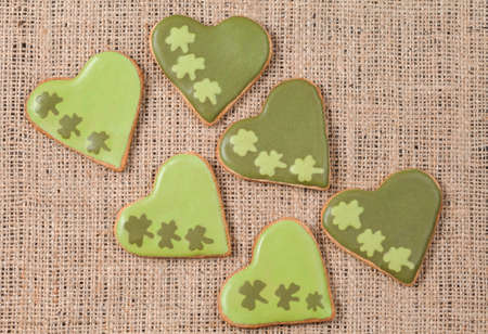 Patrick day cookies with clover on vintage textile background photo