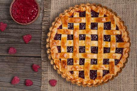 Raspberry pie with fresh raspberries and jam. Top view