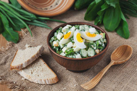 brean: Fresh spring salad with wild leak, onion, cheese, boild eggs and brean in rustic style on vintage background Stock Photo