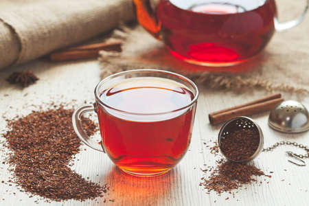 Healthy traditional organic rooibos tea with spices in rustic style.