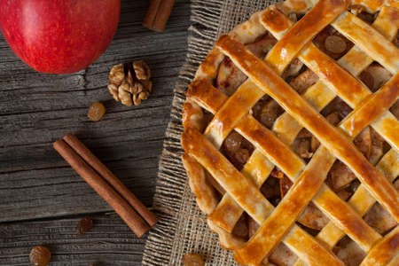 netherlandish: Apple pie with cinnamon on retro wooden background texture. Top view Stock Photo
