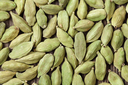 spices: Cardamom green super food indian aroma spice close up background texture