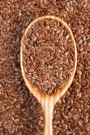 brown flax: Healthy raw brown flax seeds in vintage wooden spoon