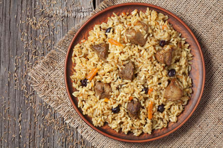 Arabic traditional national delicious rice food called pilaf cooked with fried meat, onion, carrot and garlic Stock Photo