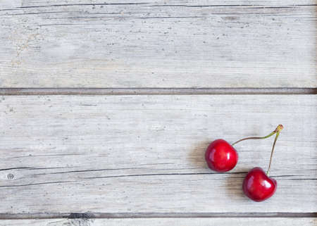 wood floor background: Cherry on vintage wooden rustic background. Natural texture wallpapper design. Rustic style.