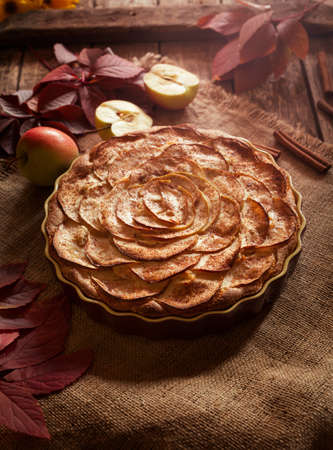 american dessert: Traditional American winter holiday celebration apple pie sweet backed dessert food with cinnamon and apples on vintage table background. Stock Photo