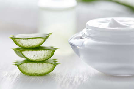 Aloe vera slices healthy natural cosmetic product with cream on white background