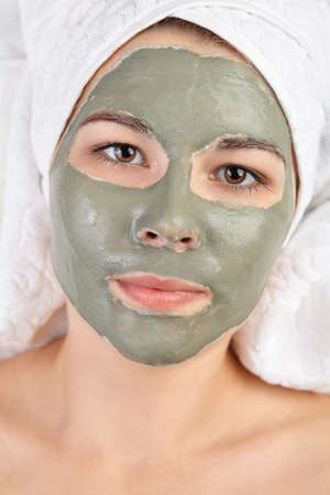 mud woman: Attractive young woman with applied mud clay mask. Stock Photo