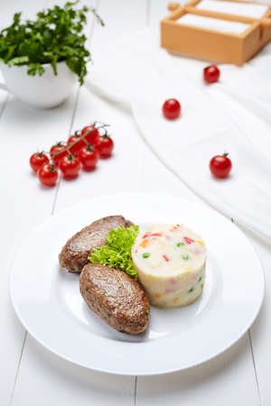 dietetic: Meat fried cutlets with mashed potatoes dietetic food and salad on white plate.