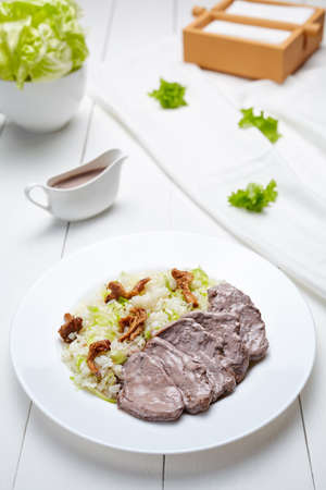 dietetic: Veal beef with rice, cream sauce, vegetables and mushrooms dietetic restaurant menu meal in white plate