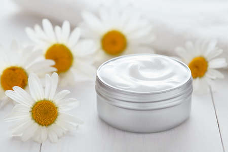 Herb cosmetic anti wrinkle cream with chamomile vitamin spa natural organic moisturizer cleansing product with towel. Dermatology hygienic anti aging, acne, blemish, pimple, blackhead clear treatment