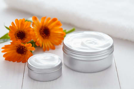 aging skin: Skin cleansing cosmetic cream with calendula flowers vitamin spa lotion natural organic herbal moisturizer product. Medical dermatology anti aging, acne, blemish, pimple, blackhead clear treatment Stock Photo