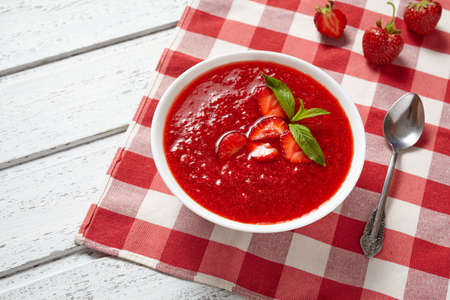 vitamin rich: Strawberry soup healthy vegetarian summer fruit dessert food, vitamin rich nutrition meal on white vintage background