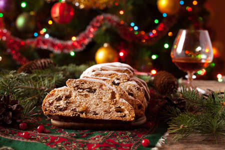 stock photo traditional german christmas cake stollen with marzipan berries nuts cinnamon raising on a rustic wooden festive table - Traditional German Christmas Decorations
