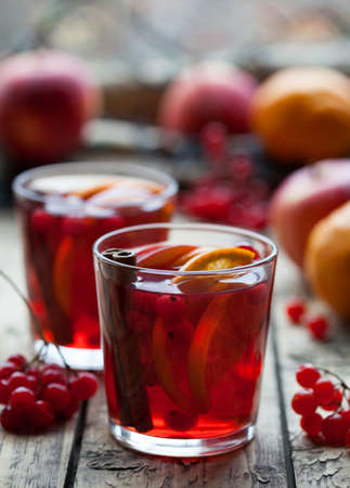 Winter warm drink. Homemade Hot Delicious Red Sangria with Berries, Oranges, Spices and Apples. Mulled wine or punch. Stock Photo