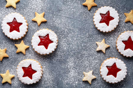 teacake: Assorted cookies. Flat layout of festive handmade cookies star on the dark surface. Top view. Sweet baking frame. Shortcrust pastry. Flat lay.