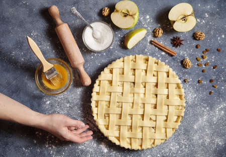 ingridients: Apple pie tart homemade American traditional cristmas dessert pastry baked food preparation recipe with ingridients flat lay on blue vintage background, top view