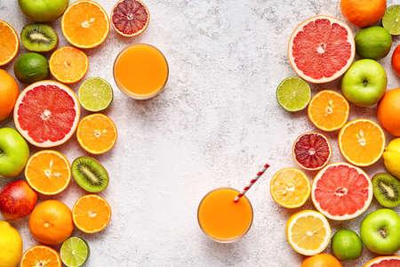 Smoothie or fresh juice vitamin drink in citrus fruits ingridient background flat lay, healthy lifestyle natural organic antioxidant detox diet beverage. Tropical summer assortment grapefruit, orange