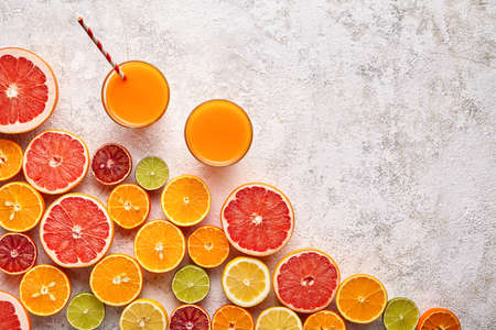 Smoothie or fresh juice vitamin drink in citrus fruits ingridient background flat lay, healthy lifestyle organic antioxidant detox diet beverage. Tropical summer assortment grapefruit, orange