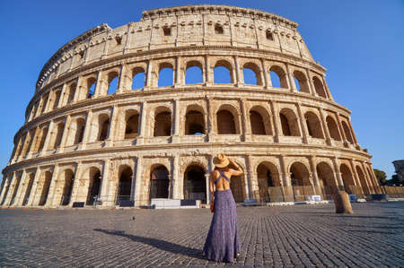 Colosseum and young tourist woman near gladiator arena