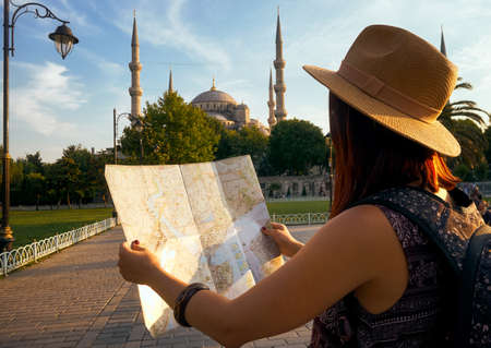 Young woman traveler tourist with map, tourism travel lifestyle
